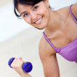 Womlifting free weights — Stock Photo #7752301