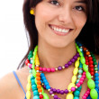 Woman with colorful necklaces — Stock Photo #7752368