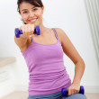 Woman exercising at home — Stockfoto