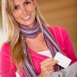 Woman taking a card from her purse — Stock Photo #7752408