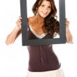 Beautiful woman with a frame — Stock Photo #7752479
