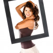 Beautiful woman with a frame — Stock Photo #7752480