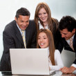 Stock Photo: Business group with a computer