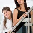 Business women smiling — Stock Photo