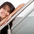 Foto Stock: Womleaning on handrail