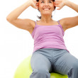 Woman exercising with a pilates ball — Stockfoto