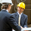 Architects at construction site — Stock Photo #7752571
