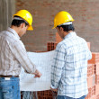Architects looking at blueprints — Stock Photo #7752633