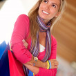 Shopping woman smiling - Stockfoto