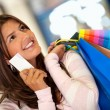 Shopping woman with a credit card — Stok fotoğraf