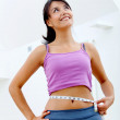 Wommeasuring her waist — Stock Photo #7752760