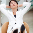 Business woman sitting on desk — Stock Photo #7753050