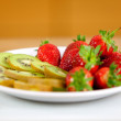 Fruits on dish — Stock Photo