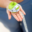Measure tape around an apple — Stok fotoğraf