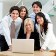 Stock Photo: Business group with laptop