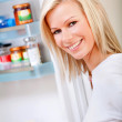 Woman opening the fridge - Stock Photo