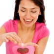 Woman holding a chocolate - Stockfoto