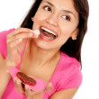Woman eating a chocolate - Foto de Stock