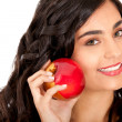 Stock Photo: Woman holding an apple