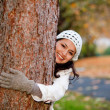 Stock Photo: Woman hugging a tree