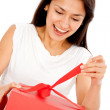 Woman opening a present - Stock Photo