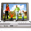 Happy family coming out of laptop — Stock Photo