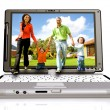 Happy family coming out of laptop — Stockfoto