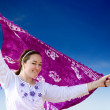 Stock Photo: Beach girl waving purple sarong