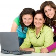 Family on a laptop computer — Stock Photo