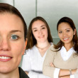 Beautiful business woman and her team — Stockfoto