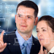 Business partners analyzing a database structure - Stock Photo
