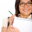 Business woman writing on a notepad — Stock Photo