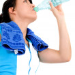 Fitness girl drinking water - Stock Photo