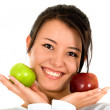 Girl holding apples - Stockfoto