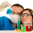 Couple of young chemistry students — Stock Photo