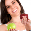 Beautiful girl holding apples — Foto de Stock