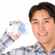 Business man holding a euro note — Stock Photo #7753987