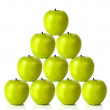 Green apples on a pyramid shape — Stok fotoğraf