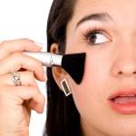 Beautiful girl applying makeup — Stock Photo