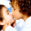 Stock Photo: Cute baby brothers kissing