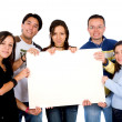 Casual group of students holding a banner — Stock Photo