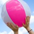 Royalty-Free Stock Photo: Beach ball held by hands