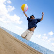Beach guy jumping with ball — Stock Photo #7754091