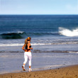 Beach female jogger - Stock Photo