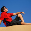Man relaxing at the beach - Stockfoto