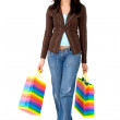 Casual girl walking with shopping bags — Stock Photo