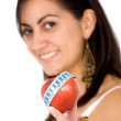 Girl holding an apple smiling — Stock fotografie