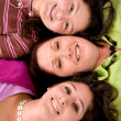 Beautiful mother and daughters — Stock Photo