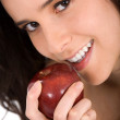 Foto Stock: Beautiful girl eating apple