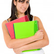 Foto Stock: Female student holding notebooks